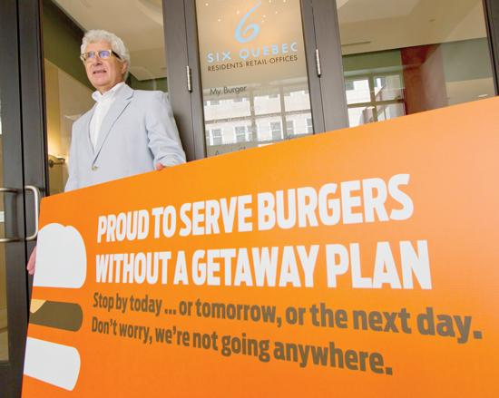 MyBurger inMinneapolis is using signs like this to try to lure people away from food trucks on the street to its skyway-level eatery.