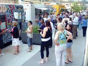 People line up for the many food trucks along Marquette Avenue in downtown Minneapolis.
