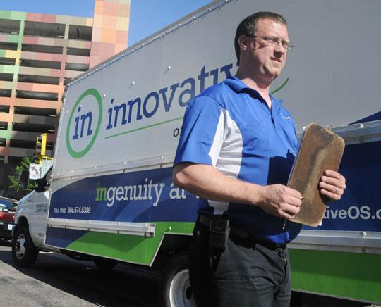 Nancy Kuehn | Minneapolis/St. Paul Business Journal  The state shutdown is costing Innovative Office Solutions up to $30,000 in daily sales, so drivers like Colin Crandell are making furniture and courier deliveries, tasks the company had outsourced.