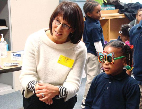 Photo provided by Phillips Eye Institute  Jean Gaslin, a volunteer with Phillips Eye Institute EYE program, at a student vision-screening program held at Jenny Lind Community School in Minneapolis