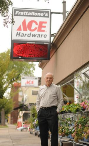 Larry Frattallone, CEO of Frattallone's Hardware Stores Inc., stands outside the company's location in Minneapolis' Uptown neighborhood. Below, Frattallone helps a customer load a door in her vehicle. He says focusing on customer service has helped the business thrive.