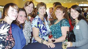 Torgerson Properties hosts an annual banquet and after party for its staff. The September event included a silent auction to benefit Give Kids the World.