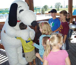 Children of Winthrop & Weinstine employees meet and greet with Snoopy at the law firm's annual family picnic at Valleyfair.