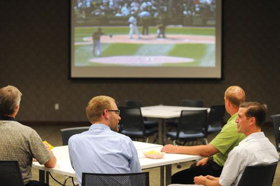 A recent employee event at AgriBank included a streaming Minnesota Twins/Chicago White Sox game, lots of food and a prize giveaway for people in attendance (inset).