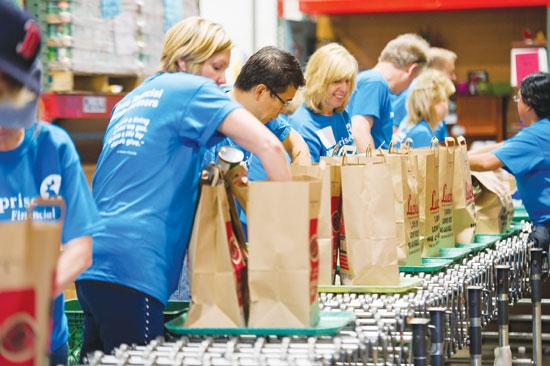 Ameriprise employees bag up food for hunger relief as part of the company's National Day of Service in November.