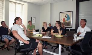 ESP IT team members share a laugh during the firm's quarterly meeting in July.