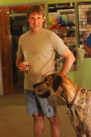 Showcraft allows employees to bring pets to work. Pictured: Shop Manager Brian Gustafson and his dog, Zeus.