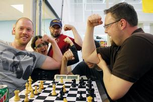 Chess masters flex their game muscles at The Nerdery. From left: Matt Luker, Annette Johnson, Matt Pacyga, Johnny Brannum (blocked by an elbow, Paul Trandem).
