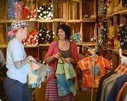 Sarah Sweet, below left, and Angela Lessman prepare their I Like You shop at the fair.