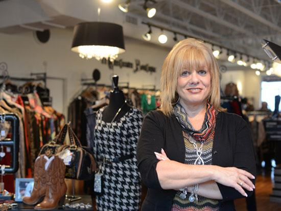 Marie DeNicola, founder, president and CEO of Mainstream Boutique, stands at the company's Apple Valley store, one of its 11 locations in Minnesota.