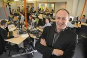 Outsell CEO Mike Wethington in the company's former developer workspace, pictured at its old location in late 2011.