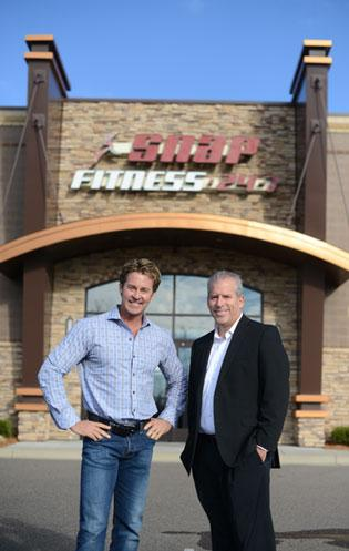 True Choice's John Butler, right, helped Snap Fitness CEO Peter Taunton move 55 Snap Fitness workers to self-insured plans.