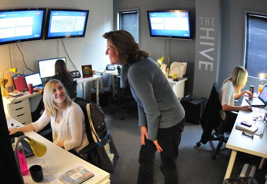 From left in forefront: Katie Hillard and Kathy Gladfelter of Bolin Marketing chat in the firm's social-media room, The Hive.