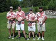 Employees participate in a golf event that raises funds for RMH.