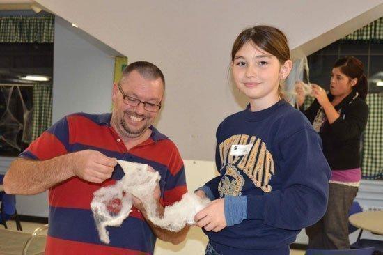 Loffler volunteers create Halloween decorations for St. Joseph's Home for Children.