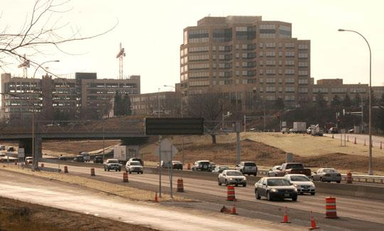 The Bren Road/Highway 169 interchange (lower left) was recently expanded at UnitedHealth's urging. The company is now adding office space and jobs to its headquarters campus (above).
