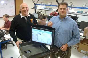 Galil Medical CEO Marty Emerson, left, and Chief Technology Officer Bill Jacqmein, with the company's system that uses compressed gas to freeze tumors in a ball of ice, destroying them.