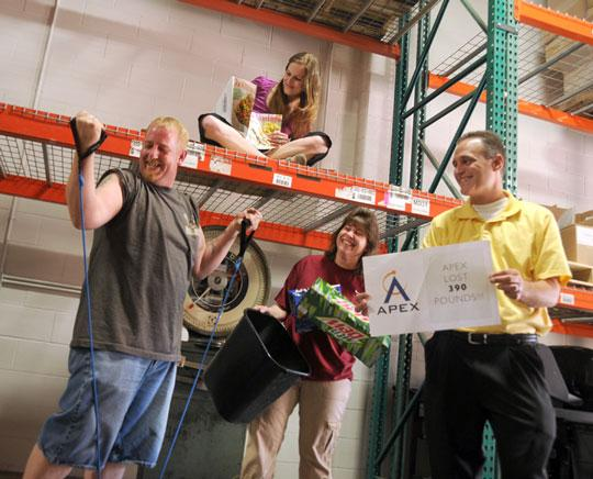Apex Print Technologies had 20 employees on two teams participate in its 'Biggest Loser' program. They lost nearly 400 pounds over three months.
