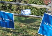 Neighboring yards in McLean express their views for this year's presidential election.
