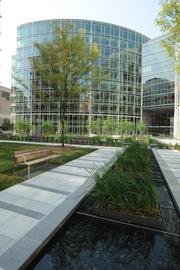 A public courtyard sits between the office and residential buildings.