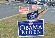 Election signs litter the median at the East Falls Church Metro station.
