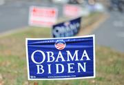 Obama-Biden signs adorn the median at the East Falls Church Metro station.