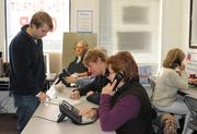 """""""GOP Victory Office"""" Director Colin Newman works the phones with staff and volunteers on the morning before the election in Leesburg's 10th District."""