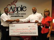 """Apple Federal Credit Union pledges to match up to $5,000 in """"Collect for Kids"""" contributions to buy school supplies for low-income Fairfax County children. From left, Capt. II Willie Bailey, aide to the assistant chief of personnel services, Fairfax County Fire and Rescue Department; and Robert Sowell and Cynthia McAree of Apple Federal Credit Union."""