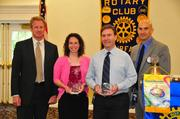 From left, Dr. Scott Pool, principal of Lanier Middle School; Teacher of the Year Award recipient Margaret Arnold of Lanier Middle School; Teacher of the Year Award recipient Robert Williams of Fairfax High School and Dave Goldfarb of The Fairfax Rotary Club.