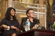 Bono was at Georgetown University on Nov. 12 to speak about social  enterprise and the power of social movements to create change at an  event co-osted by the Global Social Enterprise Initiative at the  university's McDonough School of Business and Bank of America. Bono here with Global Social Enterprise Initiative student leader and MBA student Ammu Menon.