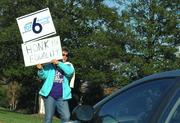 A woman stands on Georgia Avenue in Silver Spring with a sign supporting Question 6 on the Maryland ballot, the Same-Sex Marriage Referendum.