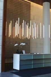A unique, custom-designed light fixture in the lobby of 2200 Pennsylvania Ave. looks like vertically hanging fluorescent tubes.
