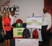 """Apple Federal Credit Union pledges to match up to $5,000 in  """"Collect for Kids"""" contributions to buy school supplies for low-income  Fairfax County children. From left, Cynthia McAree of Apple Federal Credit Union; Capt. II Willie Bailey, aide to the assistant chief of personnel services, Fairfax County Fire and Rescue Department; and Robert Sowell of Apple Federal Credit Union."""