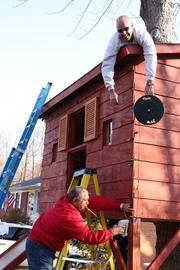 Moe Jafari of HumanTouch LLC and Jeffrey Jones of Decorate a Vet (on roof) lent their hands and decorating abilities in early December to help trick out a treehouse for the sons of a returning Iraqi veteran. The efforts were part of Decorate a Vet, a nonprofit organization that assists northern Virginia veterans with home repairs and support.  See more photos from the Jan. 6, 2012 edition of The Back Page Extra.