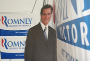 """A Mitt Romney cardboard cutout at the """"GOP Victory Office"""" in Leesburg's 10th District."""