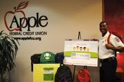 """Apple Federal Credit Union pledges to match up to $5,000 in  """"Collect for Kids"""" contributions to buy school supplies for low-income  Fairfax County children. Capt. II Willie Bailey, aide to the assistant chief of personnel services, Fairfax County Fire and Rescue Department, showcases items donated so far."""