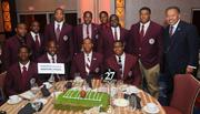 Events for the AT&T Nation's Football Classic began Aug. 30 with the Presidential Symposium at Howard University. Morehouse College President Robert Franklin and Howard University President Sidney Ribeau hosted the event. Members of the Morehouse Maroon Tigers football team pose with Morehouse College President Rpbert Franklin, far right.