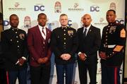 Events for the AT&T Nation's Football Classic began Aug. 30 with the Presidential Symposium at Howard University. Morehouse College President Robert Franklin and Howard University President Sidney Ribeau hosted the event. Morehouse College's Shelton Hamilton Jr., second from left, and Howard University's Anthony Whitlow, second from right, pose with members of the United States Marine Corps after being awarded the Excellence in Leadership Award at the welcome dinner.