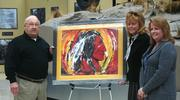Three pieces of artwork honoring military personnel have found new homes  at the National Museum of the Marine Corps. Azalea Chairities founder and chairman Frank Lasch, museum director Lin Ezell and museum curator Vickie Stuart-Hill.