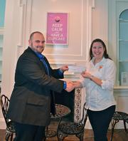 Occasionally Cake raised more than $1,700 during their Old Town Alexandria grand opening, where they donated 25 percent of sales to the Dunbar Alexandria-Olympic Branch of Boys & Girls Clubs of Greater Washington. Chad Merica, left, branch director at Alexandria Boys & Girls Club, receives the donation from   Occasionally  Cake owner Sabrina Campbell.