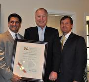The Bethesda office of Long & Foster has reached a major milestone: The office has handled more than $1 billion in settled real estate volume. From left, Long & Foster Senior Office Manager (Bethesda) Leon Nasar, Maryland Comptroller Peter Franchot and Long & Foster Real Estate Inc. President Gary Scott.