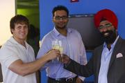 From Gryphn Corp., Aaron Huttner, left, chief technology officer; Bobby Saini, chief marketing officer; and Navroop Mitter, CEO; celebrate the one-year anniversary of their mobile security company.