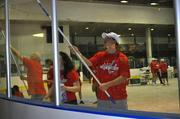 Washington Capitals defenseman John Carlson, mascot Slapshot and 100 Caps fans participated in a Capitals service project to help clean up Fort Dupont Ice Arena in Southeast D.C. on June 2. Carlson helped Caps volunteers wash the glass at Fort Dupont Ice Arena.