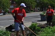 Washington Capitals defenseman John Carlson, mascot Slapshot and 100 Caps fans participated in a Capitals service project to help clean up Fort Dupont Ice Arena in Southeast D.C. on June 2. Carlson helped Caps volunteers weed the tree boxes outside of Fort Dupont Ice Arena.