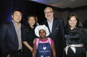 Celebrity Chef and Common Threads co-founder Art Smith with Robert Kang, NBC 4's Eun Yang, Mary Beth Albright and one of the children from the Common Threads after-school cooking program.