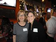 The Arlington Chamber of Commerce packed World of Beer in Ballston on Dec. 4 for a holiday party with co-sponsors, the Ballston Business Improvement District. Brenda Krieger of Dweck Properties, left and Lily Carhart.