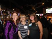 The Arlington Chamber of Commerce packed World of Beer in Ballston on  Dec. 4 for a holiday party with co-sponsors, the Ballston Business  Improvement District. From left, Tina Leone of Ballston BID, Brenda Krieger of Dweck Properties and Catherine Roper of Ballston BID.