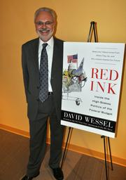 """Qorvis Communications celebrated the publication of """"Red Ink: Inside the  High Stakes Politics of the Federal Budget,"""" by David Wessel, economics  editor of The Wall Street Journal, during a reception Aug. 2 at its  D.C. offices."""