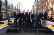 D.C. Mayor Vincent Gray, Congresswoman Eleanor Holmes Norton and Ward 2  Councilmember Jack Evans were among those celebrating the  opening of  Trilogy NoMa, a 603-unit, Class A multifamily community and new section  of Q Street, on Nov. 29.