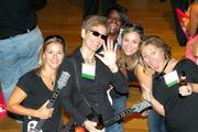 """The Fairfax Chamber of Commerce fired up the karaoke machine for a good cause Aug. 23 during its Char-a-oke event at the Barns of Wolf Trap. The evening pulled in more than $30,000 for Fairfax County Public Schools. The team from Deloitte LLP, led by Southeast Community Leader Emily Rothberg, center, rocked out to a new Bon Jovi tune, """"We Weren't Born to Follow."""" See more photos from the Sept. 7, 2012 edition of The Back Page Extra."""